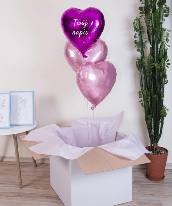 Trzy różowe balony wypełnione helem z Twoim napisem